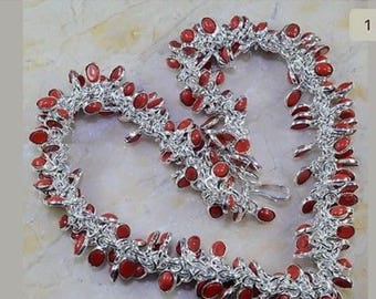 Red untreated red coral set in ss 19 inches in length