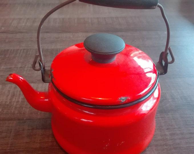 Orange enamel kettle