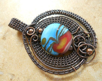 copper woven oxidized pendant with etched red & blue lentil bead