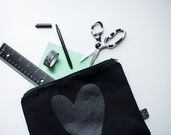 Black heart on black pouch stitched and silkscreened by hand by BlackSnaps.