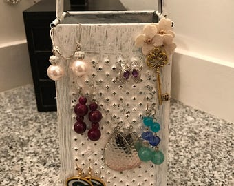 Cheese grater earring holder.