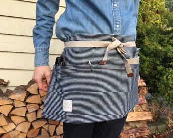 Waist apron made with striped railroad denim. With three wide front pockets. Vintage bias tape, leather tips. Perfect shop apron lap apron