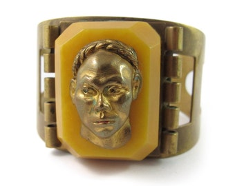 French vintage carved galalith and brass figural face cuff c.1930