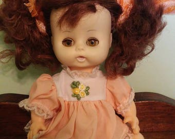 Vintage Doll - brown hair and peach colored dress