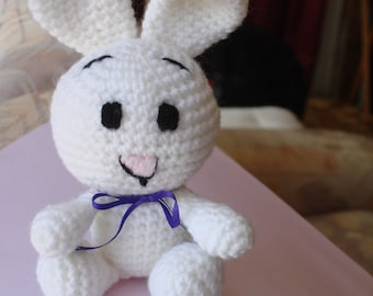 Bunny Rabbit crocheted in White 8 ply Acrylic Yarn with Purple Ribbon