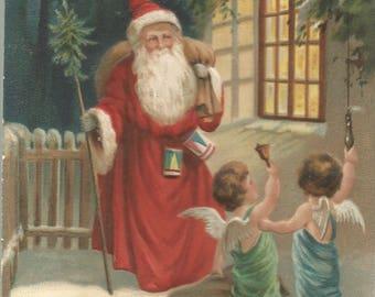 Vintage MAB Postcard 1912, Christmas Greeting Santa Claus Long Red Coat Pine Tree Walking Stick Angel Children