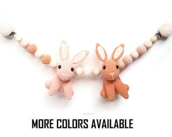 Stroller toy with bunnies
