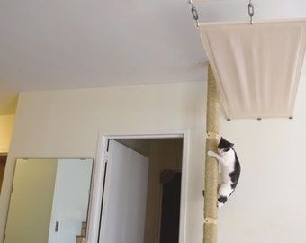 Cat Pole! Cats can climb from floor to ceiling for play and exercise. Turn your bookcase or cabinets into a cat duplex.