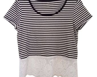 Black and white striped short sleeved top with white lace detail - size medium