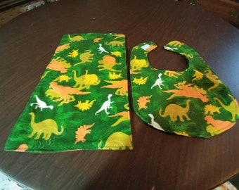 Dinosaurs bib and burp cloth set.