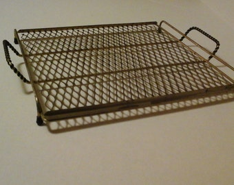 12 Inch Square Metal Mesh Rack, Brass Tone, Plastic Wrapped Handles, Rubber Feet