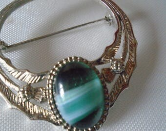celtic style brooch green glass stone
