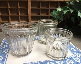 3 old jam jars