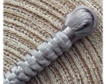 Silvery, grey color silk threads coils sold by 2