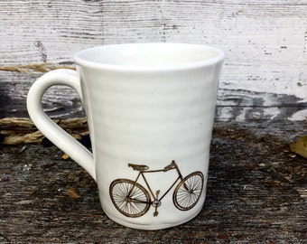 Gold bicycle white pottery mug