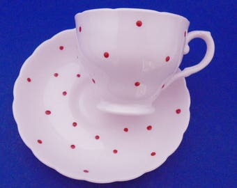 Tuscan pastel pale blush pink red enamel raised polka dots tea cup and saucer raised dot soft rainbow pink