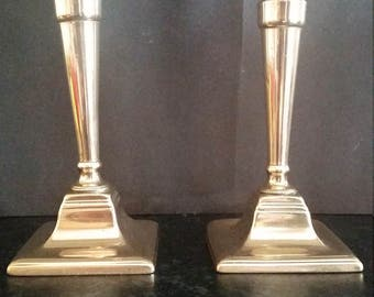 William Harrison 18thc Brass or Bell Metal Candlesticks Plus One Petal Based Candlestick.