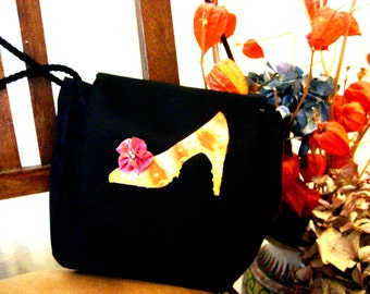 black handbag for women with drawn in the middle a silk shoe