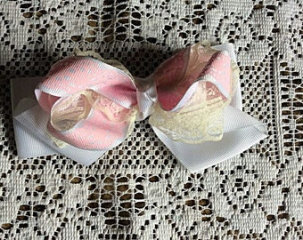 One (1) Creme, White, and Pink Bow Hair Clip