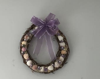 Beach decor, beautiful grapevine wreath with dried flowers and shells