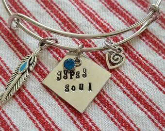 Adjustable  bangle bracelet //Gypsy soul //Hand stamped bangle// Pewter gypsy soul bangle //Feather charm with a beautiful blue crystal .