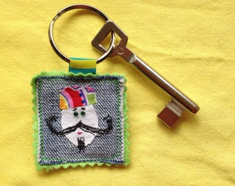 Keychain Mr, see key, upcycling textile collage