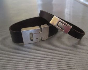 Set of two leather bracelet with silver-tone claps