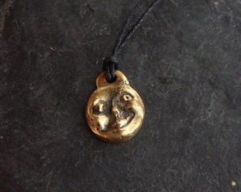 Moon, brass locket