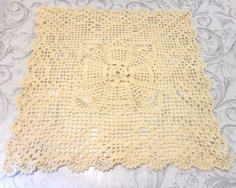 Square doily knitted by hand with a wire color cotton cream. Decorate a table with a delicate doily.