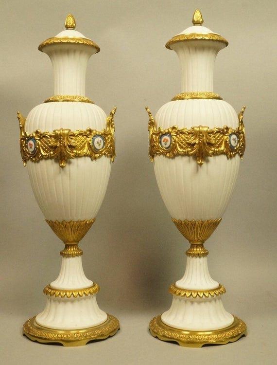 Antique pair of porcelain bisque Urns.