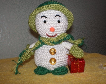 Snowman with gift. Knitted soft toy.