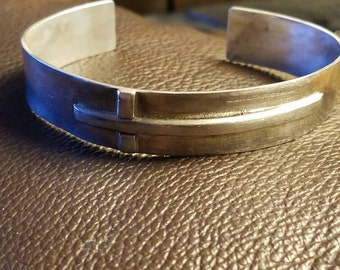 Sterling silver sideways cross cuff style bracelet