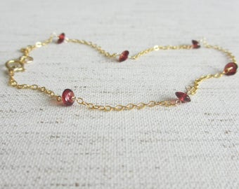 Gold filled anklet with red garnet gemstones