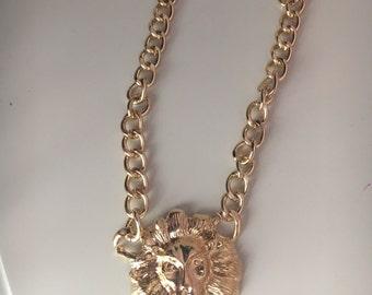 Gold lion pendant necklace