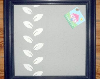 Black, grey and white square pin board