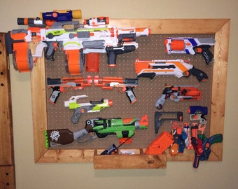 Nerf gun storage rack. Pegboard 36x48 or customize your own size and color! Please contact us for shipping quote before order is placed!