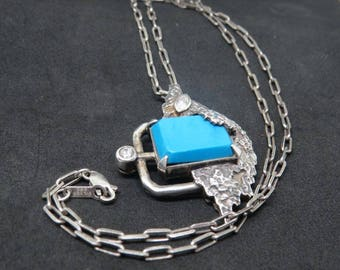 Antique Silver and Turquoise Artistic pendant