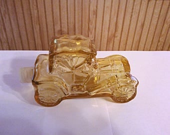 Avon Packard Roadster cologne bottle, car shaped amber glass bottle made in the 1970s for Avon.