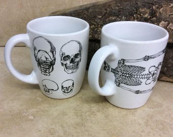 Set of two white ceramic cups