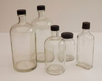 Series of 5 former apothecary, laboratory, pharmacy French Vintage bottles. Molded glass jars. Cabinet of curiosities