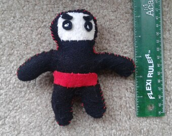 Felt ninja with weapon