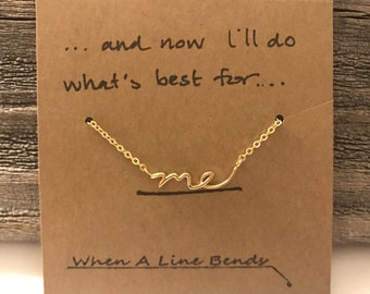 "Gold ""me"" necklace"