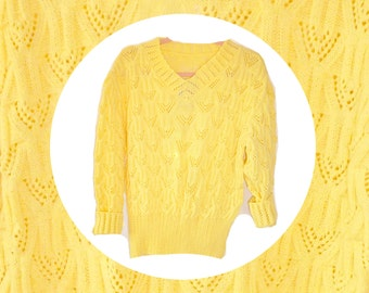 A beautiful yellow knit 1980's vintage jumper with ribbed button sleeves and stretch ribbed bottom