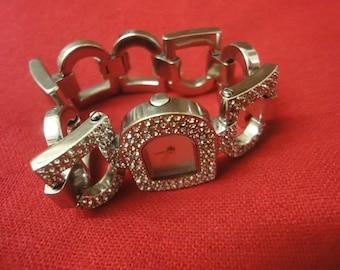 Ladies DKNY designer watch in silver encrusted inside DKNY BOX