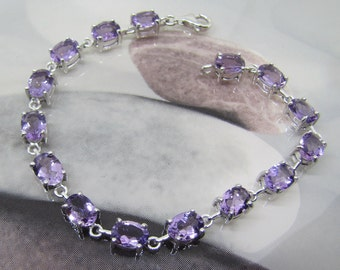 925 sterling silver bracelet adorned with 15 natural amethysts. 25% with code: SOLD17