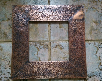 Copper mirror frame on pine wood  hand hammered