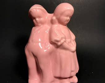 Figural Boy and Girl Planter Vase