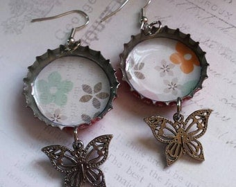Coca Cola bottle cap earrings with butterfly accent