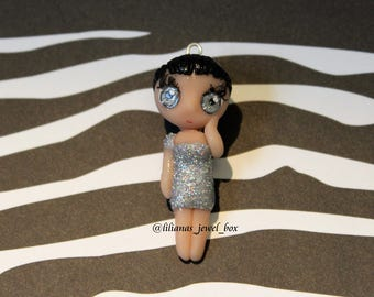 Handmade polymer clay chibi girl charm with holographic glittery dress