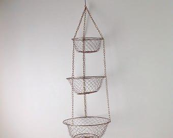 Vintage tiered metal hanging baskets